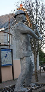 Statue of miner with raised pick