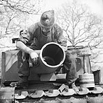 The 29cm Petard spigot mortar on a Churchill AVRE of 79th Squadron, 5th Assault Regiment, Royal Engineers, under command of 3rd Infantry Division, 29 April 1944. A 40lb bomb can be seen on the right. H38001.jpg