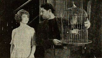 The Bonded Woman - Film still with Compson and Bowers.