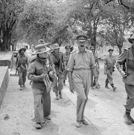 Major General T. W. Rees (on the left) talking with Lieutenant General Sir Oliver Leese, 19 March 1945, wearing a red scarf. The British Army in Burma 1945 SE3465.jpg