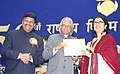 The President Dr. A.P.J. Abdul Kalam presenting the Best Direction Award for the year 2002 to Aparna Sen at the 50th National Film Award function in New Delhi on December 29, 2003.jpg