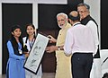 The Prime Minister, Shri Narendra Modi being presented a portrait of him, at Livelihood College, in Dantewada, Chhattisgarh on May 09, 2015. The Chief Minister of Chhattisgarh, Dr. Raman Singh is also seen.jpg