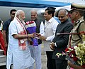 The Prime Minister, Shri Narendra Modi being welcomed by the Governor of Assam, Shri Banwarilal Purohit and the Chief Minister of Assam, Shri Sarbananda Sonowal on his arrival, in Dibrugarh, Assam on May 26, 2017 (1).jpg