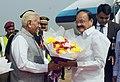 The Vice President, Shri M. Venkaiah Naidu being received by the Governor of Karnataka, Shri Vajubhai Vala, on his arrival, in Hubli, Karnataka on September 26, 2017.jpg