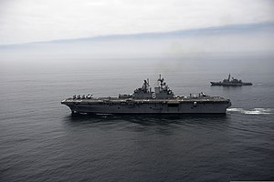 The amphibious assault ship USS America (LHA 6), front, and a Peruvian Navy ship sail in formation during a passing exercise in the Pacific Ocean Sept 140903-N-MZ309-722.jpg