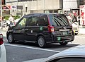 The rearview of Toyota JPN TAXI Takumi (DAA-NTP10-AHXGN) as a taxi of Yuko Taxi.jpg
