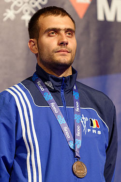 Tiberiu Dolniceanu podium 2013 Fencing WCH SMS-IN t205911.jpg