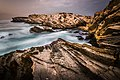 Tilted Jurassic Carbonate Rock Layers at Baleal in Portugal.jpg