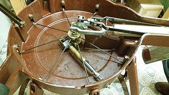Timpani - The inside, bottom of a Yamaha pedal timpano, showing the mechanical tension-adjusting system