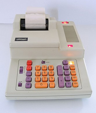 Calculator - An office calculating machine with a paper printer.