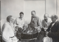 Tolstoy and wife and two sons play chess.png