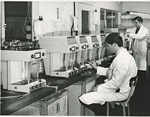 Torbal employees inspecting a line of scales in the laboratory Torbal Lab Research.jpg