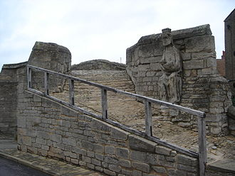 Trinity Bridge, Crowland - The seated figure is thought to be that of Christ or king Ethelbald and is possibly from the west front of the Croyland Abbey.