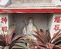Tu Di Gong at a tomb.jpg