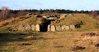 Passage grave - Tustrup-dysserne, the largest passage grave in Eastern Jutland, is an example of Funnelbeaker culture circa 3200 BC.