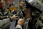 U.S. Air Force Staff Sgt. Robert Colliton helps CAP cadet try on equipment in Okinawa.jpg