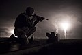 U.S. Army Spc. Brett Hawley, assigned to Alpha Company, 98th Expeditionary Signal Battalion, 505th Theater Tactical Signal Brigade, 335th Signal Command, fires an M4 carbine rifle during a nighttime fire 130626-A-IN286-011.jpg