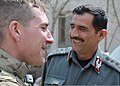 U.S. Army Task Force Cujo team leader Sgt. Scott Shively, left, with the 1186th Military Police Company, Oregon Army National Guard, laughs with the District 11 deputy police chief Col. Mohammad Arif after a key 120401-N-VN372-004.jpg