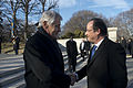 U.S. Defense Secretary Chuck Hagel greets French President Francois Hollande at Arlington National Cemetery in Arlington, Va 140211-D-BW835-040.jpg