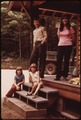 U.S. FOREST SERVICE RANGER AND FAMILY AT MARCY DAM NEAR LAKE PLACID. THE STATE PROVIDES THE FAMILY WITH A COMFORTABLE... - NARA - 554447.tif