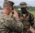 U.S. Marine Corps Maj. Gregory Starace, an Armed Forces of Liberia (AFL) Armed Forces Training Command mentor, returns an AFL soldier's salute at Roberts International Airport in Monrovia, Liberia, June 22 130622-F-UV166-020.jpg