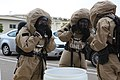 U.S. Marine Corps chemical, biological, radiological and nuclear (CBRN) defense specialists with Marine Wing Headquarters Squadron (MWHS) 3, 3rd Marine Aircraft Wing, suit up in level B hazardous material suits 130430-M-EF955-193.jpg
