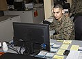 U.S. Marine Sgt. Xavier Velez, a data systems specialist with the 26th Marine Expeditionary Unit (MEU), a Terryville, Conn., native, maintains a network in the MEU's command post, aboard Marine Corps Base Camp 131211-M-AW179-534.jpg