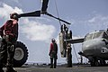 U.S. Marines and Sailors aboard the amphibious assault ship USS Kearsarge (LHD 3) move a rotor for an MV-22B Osprey tiltrotor aircraft assigned to Marine Medium Tiltrotor Squadron (VMM) 266 during maintenance 130504-M-ZC556-009.jpg