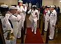 U.S. Navy Chief Machinist's Mate Roderick Williams salutes as he passes by sideboys during his retirement ceremony at Barksdale Air Force Base, La., Aug. 11, 2012 120811-N-YU482-003.jpg