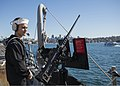 U.S. Navy Fire Controlman 2nd Class Cameron Svedarsky stands watch as part of a small-caliber action team aboard the guided missile destroyer USS Momsen (DDG 92) during Talisman Saber 2013 in Sydney July 29 130729-N-HI414-086.jpg