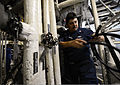 U.S. Navy Hull Maintenance Technician 1st Class Jaime Martinez repairs the cooling system on the littoral combat ship USS Freedom (LCS 1) during sea trials in preparation for Cooperation Afloat Readiness 130610-N-JN664-132.jpg