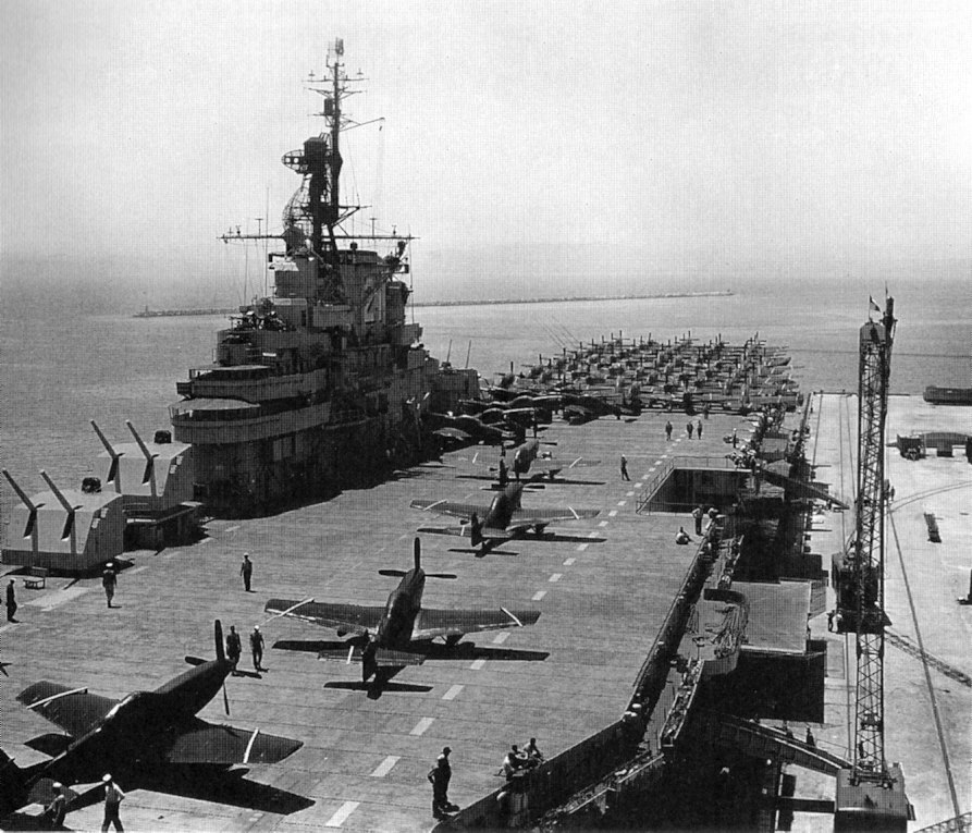 USS Boxer (CV-21) loading F-51 Mustangs at NAS Alameda in July 1950 (80-G-418776)