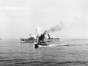 USS Savannah (CL-42) is hit by a German guided bomb, off Salerno, 11 September 1943.jpg