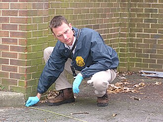 Criminal investigation - A U.S. Army Criminal Investigation Command special agent processes a crime scene on an Army installation.