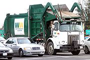 A typical front loading garbage truck in North America.