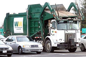 A standard Waste Management Inc. front-loading...