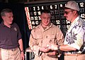 US Navy 030209-N-2972R-098 CO, CMC of USS Kearsarge (LHD 3) present over 2,000 dollars in prize money to winner of bingo tournament.jpg