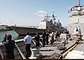 US Navy 030425-N-5067K-008 Sailors aboard USS Lake Chaplain (CG 57) man the rails in tribute to USS Mobile Bay.jpg