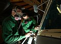 US Navy 040123-N-7090S-001 Aviation Structural Mechanic 3rd Class Jessie Woolf from Mesa, Ariz. and Aviation Electrician's Mate Airman Rhett Taylor from Dayton, Fla., seal the windshield of an SH-60 Seahawk.jpg