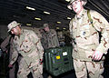 US Navy 040327-N-6380E-019 U.S. Marines assigned to 22nd Marine Expeditionary Unit (22nd MEU) Special Operations Capable (SOC) offload supplies in support of their mission in the 5th Fleet Area of Responsibility (AOR).jpg
