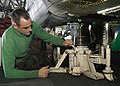 US Navy 040606-N-9630B-009 Aviation Machinist's Mate 2nd Class Robert Henry of Lewiston, Minn., adjusts a hydraulic jack while performing maintenance on an HH-60H Seahawk.jpg