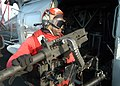 US Navy 041028-N-4565G-001 An Aviation Ordnanceman assigned to the Red Lions of Helicopter Anti-Submarine Squadron One Five (HS-15) prepares to mount a 50-caliber machine gun.jpg