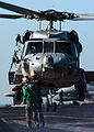 US Navy 041129-N-4308O-050 Aviation Electrician's Mate 3rd Class Megan Truncer assigned to the Dusty Dogs of Helicopter Anti-Submarine Squadron Seven (HS-7), communicates with the pilot of an SH-60 Seahawk helicopter via hand s.jpg