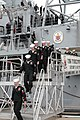 US Navy 041203-N-4397B-003 Crew members, assigned to the guided missile cruiser USS Yorktown (CG 48), file-off the ship as she is decommissioned on board Naval Station Pascagoula, Miss.jpg