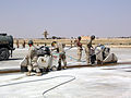 US Navy 060320-N-2095S-001 Seabees assigned to Naval Mobile Construction Battalion (NMCB) 25 cut through damaged sections of concrete on an airstrip in Al Anbar Province.jpg