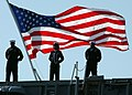 US Navy 070323-N-3285B-017 Sailors stationed aboard USS John F. Kennedy (CV 67) man the rails during the ship's decommissioning ceremony.jpg