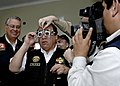 US Navy 070809-N-6278K-257 Luis Alva Castro, Peru's minister of interior, has eyeglasses fitted for him by an optometrist attached to Military Sealift Command hospital ship USNS Comfort (T-AH 20).jpg