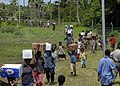 US Navy 070811-N-4267W-072 osephstaal villagers help carry supplies from a landing zone to a remote project site where Seabees assigned to Naval Mobile Construction Battalion (NMCB) 7, Amphibious Construction Battalion (ACB) 1.jpg