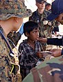 US Navy 071204-N-4774B-201 An 11-year-old boy is treated by Lt. Cmdr. Lu Le, a translator, and other members of a U.S. Navy Fleet Surgical Team from the amphibious assault ship USS Tarawa (LHA 1).jpg