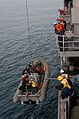 US Navy 071218-N-1831S-049 Crewmembers aboard the guided-missile frigate USS Carr (FFG 52) send a RHIB to recover OSCAR during a man-over drill.jpg